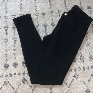 J Brand black skinny jeans with rips at knees